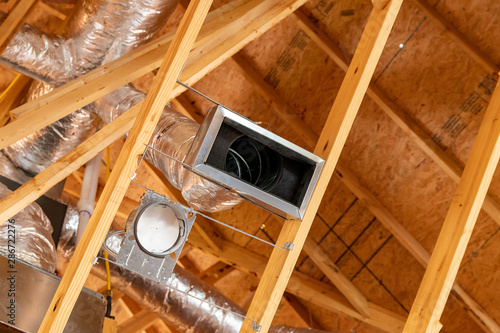 Fotografía  New air conditioner vents in new home construction