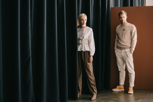Full Length View Of Elegant Blonde Woman And Bearded Man Standing Near Curtain