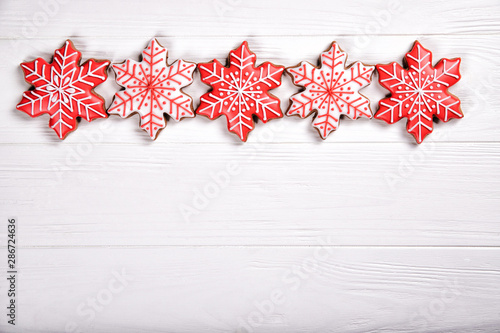 Christmas snowflake cookies on a white background Wallpaper Mural