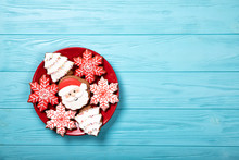 Red Plate With Christmas Cookies On A Blue Background. With Place For Text.
