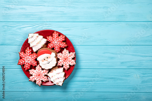 Red plate with christmas cookies on a blue background Wallpaper Mural