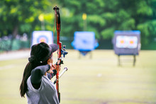 Woman Archer Shooting With His Bow