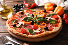 Delicious Pizza And Ingredients On Wooden Background, Close Up