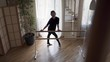 Flexible mature woman practicing at home. Elegant slim woman in black clothes doing exercises indoors. Happy life, keeping in shape.