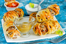 Halloween Mummies - Meatballs Wrapped In Dough With Funny Eyes , Funny Idea For Halloween Party Snack Food