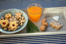 Christmas Breakfast On Wooden Tray, Fresh Orange Juice Gingergread, Shortcrust Pastry Cookies And Pour Feliciter Pig 2020