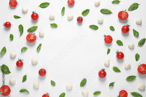 Fototapeta Flat lay composition with fresh pizza ingredients on white background. Space for text obraz