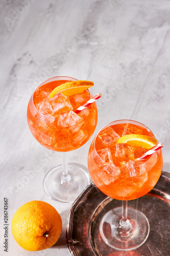 Fototapeta Refreshing Aperol Spritz cocktail with ice and slice of orange obraz na płótnie