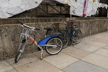 Two Bicycles Are Parked Near T...
