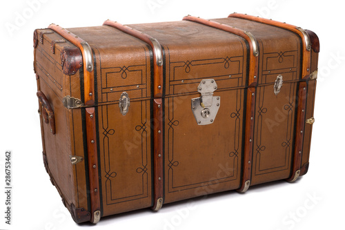 Obraz na plátně Antique Tin Travel Trunk Steamer Chest closed isolated on white background