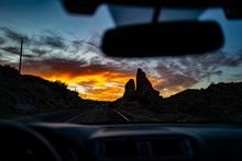 A Large Rock Seen From A Car In The Desert Near Pioneertown, California