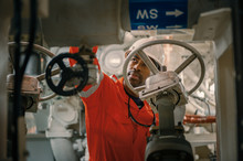 Employee Inspect Machinery On Offshore Vessel