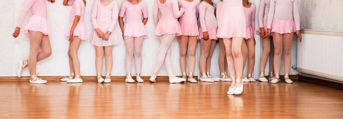 Little girls learn to dance ballet at dance school