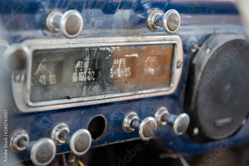 Dashboard at front of abandoned vintage truck with ammeter, oil indicator, vario Canvas Print