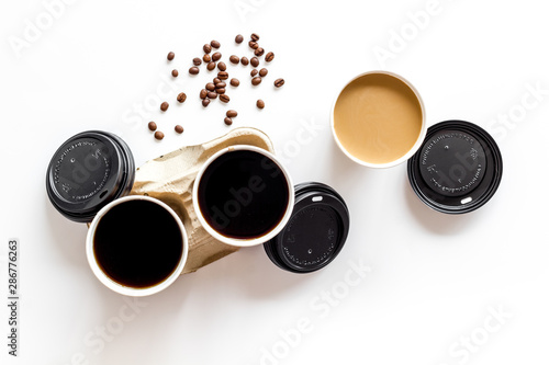 Caution: contents hot. Coffee to go on white background top view