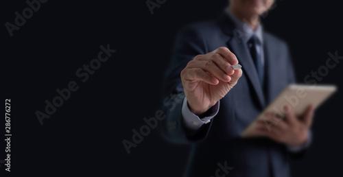 Fototapeta  Businessman writing on virtual screen