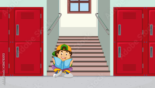 Tuinposter Kids Boy at school stairs reading a book