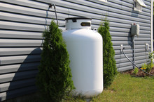 A Large Propane Tank On The Side Of A House