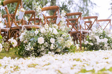 Wedding Ceremony. Arch, Decorated With Flowers.