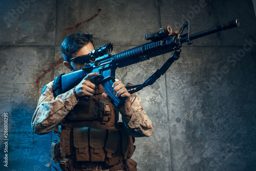 Valokuva  American private military contractor holding rifle