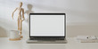 canvas print picture Blank screen laptop computer in minimal workplace with  office supplies and decorations