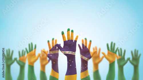Deurstickers Brazilië Brazil flag on people palm hands raising up for volunteer, voting, help wanted, and national holiday celebration praying for Brazilian power isolated on blue sky background (clipping path)