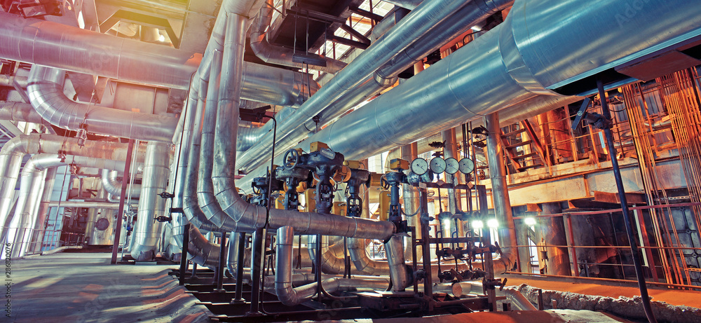 Fototapeta Equipment, cables and piping as found inside of a modern industrial power plant