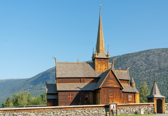Fototapeta na wymiar Wooden church Lomskyrkja in Lom, Norway, one of the biggest stave churches in Norway. Church dates back to 1158-59.