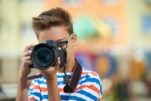 Funny Teen Boy With Digital Photo Camera