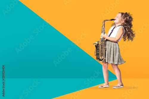 a female gradeschooler saxophonist - 286826406