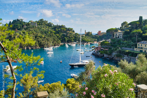 Portofino, Italy - AUGUST 15, 2019: Beautiful harbor in the Italian Riviera, hou Fotobehang