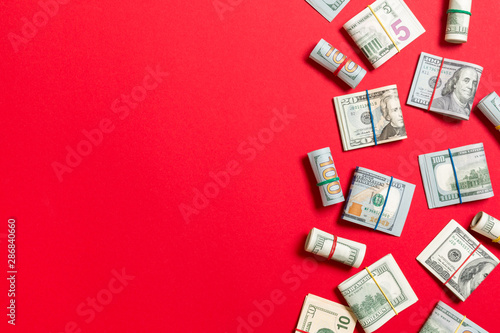 Fototapeta Dollar bills. Pile of one hundred US Dollar Bills money on colored background top wiev with copy space for your text in business concept obraz