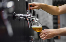 Bartender Hand At Beer Tap Pou...