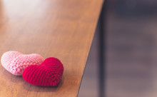 Red And Pink Hearts On Wooden Table With Beautiful Blurred Background