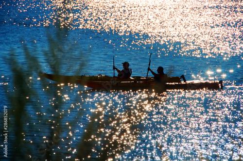 Fototapeta  Sea Kayakers in Blue Twilight