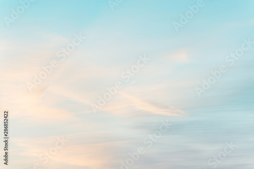 Garden Poster Light blue sunset background. sky with soft and blur pastel colored clouds. gradient cloud on the beach resort. nature. sunrise. peaceful morning. Instagram toned style