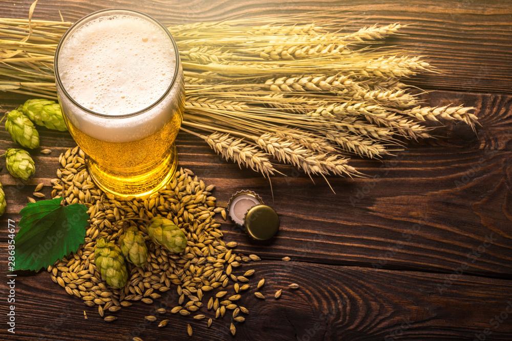 Fototapety, obrazy: Beer in mug on wooden table
