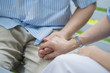 Close up hand of couple gesture, hope for Rescue or helping female touch hand man for encouragement. Hands of female holding the hand a man. Parkinson, alzheimer, senior, elderly and caregiver concept