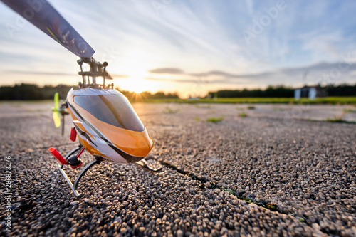 Türaufkleber Hubschrauber A RC helicopter standing on the ground during sunset on a beautiful summer day