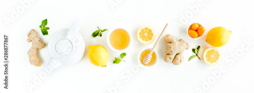 Herbal tea with mint, ginger, lemon, honey and other herbs on white background Canvas Print