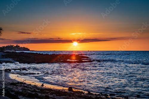 Orange sunset on a beach in Hawaii