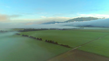 AERIAL Thick Clouds Of Fog Spr...