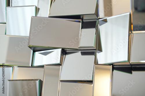 Obraz Mirror with foursquare in wall, decoration and reflection. Abstract glass background. Polygonal surface. Close-up. Texture. - fototapety do salonu