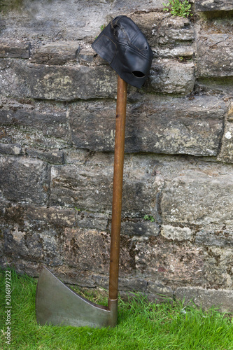 Fotografia, Obraz  Medieval executioner's axe used for capital punishment and headsmans leather mas