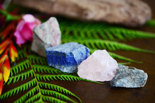 Rough Crystals In Woman's Hand With Natural Lighting. Raw Rose Quartz, Raw Lapis Lazuli, Raw Unakite, And Raw Ocean Jasper. Beautiful Crystal Display, Crystals And Plants, Macro Photography