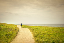 Man Walking On A Lonely Path T...