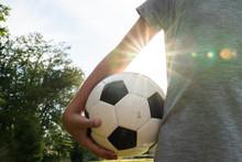 Girl Holding A Soccer Ball At Sunset