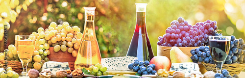 Red and white wine and grape on table - rich autumn harvest - 286913811