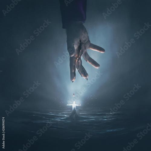Fotografia Hand of Jesus and glowing man