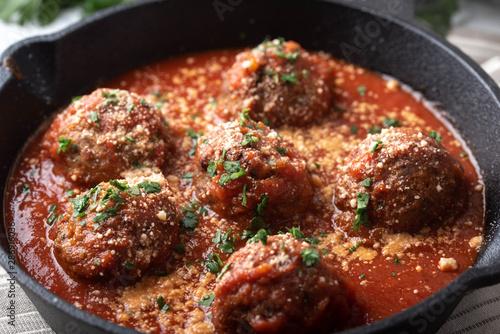 Obraz na plátně meatballs with tomato sauce in cast iron skillet